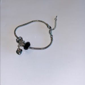 Sliding silver chain and charm bracelet